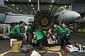 Sailors conduct maintenance on a jet engine in the hangar bay of USS Dwight D. Eisenhower. (25686253733).jpg