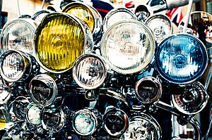 Headlamp - A motor scooter's front with an impractical number and variety of headlamps, added for decorative purposes and characteristic of Mod culture