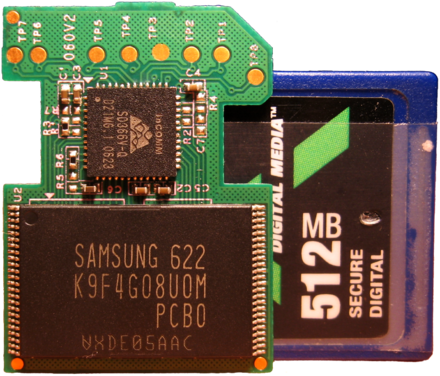 Inside a 512 MB SD card: NAND flash chip that holds the data (bottom) and SD controller (top) Sd insides.png