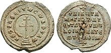 Lead seal with cross surrounded by legend on the obverse and a simple legend in the reverse