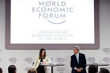 Secretary Kerry Listens as Senior Adviser Ballou-Aares Introduces Him to Address the Young Global Leaders Forum at the World Economic Forum in Davos (24225948630).jpg