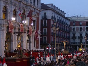 Holy Week - The General Good Friday Procession in Valladolid, Spain outside of a large facility.
