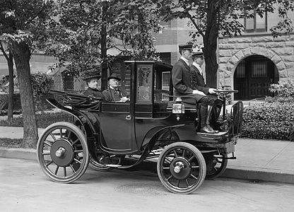 "Senator George P. Wetmore of Rhode Island in ""Krieger Electric Carriage"" automobile, 1906"