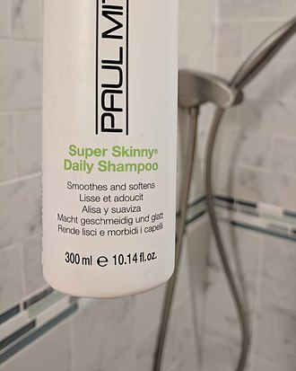 Metrication in the United States - A shampoo bottle labeled with mL first and fl oz second. Note the ℮ estimated net quantity symbol indicates the product also conforms to European Union regulations.