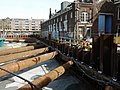 Sheet piling and rusty construction tubes around the large excavation concrete - in Amsterdam-West - Bouwput voor De Hallen, Kinkerbuurt amsterdam.jpg