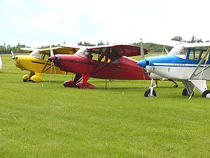 Fly-in - A fly-in of Short Wing Piper aircraft from an Aircraft type club. The aircraft are (l-r) a Piper PA-17 Vagabond, a Piper PA-16 Clipper and a Piper PA-22-150 Tri-Pacer