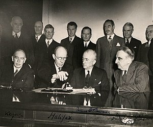 Anglo-American loan - Signature of the loan. Bottom row from left: economist John Maynard Keynes (leader of the British negotiators), Lord Halifax, British Ambassador to the USA, James F. Byrnes, United States Secretary of State, Fred M. Vinson, United States Secretary of the Treasury. Future US Secretary of State Dean Acheson stands third from right in the back row.