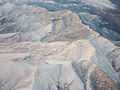 Snow covered peaks near Las Vegas (8377558798).jpg