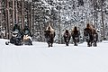 Snowmobiles passing bison on the road (3) (59f2579e-c91f-437c-99c3-62c2af6fea5a).jpg