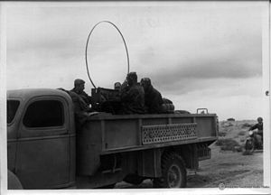 First Battle of Bir el Gubi - Italian soldiers with a radio positioned on a truck at Bir el Gubi in Nov 1941