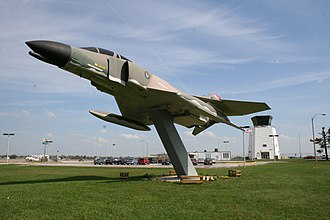 St. Louis Regional Airport - F-4 Phantom II on display at the airport with the control tower in the background