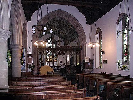 Inside the Anglican Parish Church of Saint Lawrence in Bourton-on-the-Water, England St Lawrence's Church nave and chancel, Bourton-on-the-Water, Gloucestershire.jpg