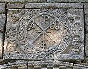 Right-angle labarum, retaining the horizon: Romanesque carving at Santa Maria de Cóll, Vall de Boí, Spain