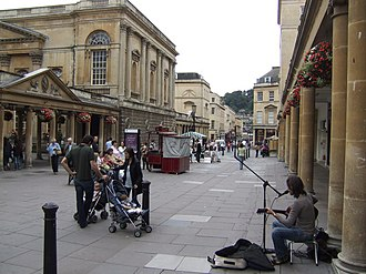 Stall Street, Bath - Buskers in Stall Street showing the north and south colonnades of the Grand Pump Room