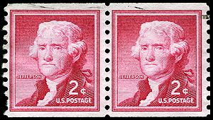 Perforation - Perforation holes on a pair of coil stamps