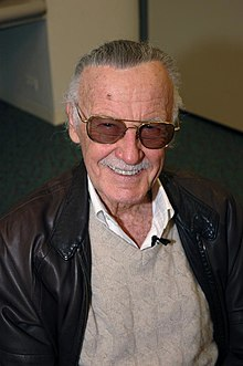 Superhero legend, Stan Lee smiling for the camera with his iconic shades.