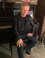 Stephen Auerbach in front of the Elvis Presley piano.png