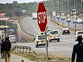 Stop sign on the busy highway.jpg