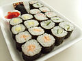 Sushi platter with omelette, cooked salmon, kani and cucumber sushi.jpg
