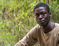 Tanzania - Young guide at Arusha National Park (14347845649).jpg