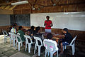 Teacher Thelma Awasi teaches the students skills in agriculture including organic farming and keeping chickens. (10728453234).jpg