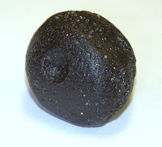 Tektite - A simple, spherical splash-form Indochinite tektite