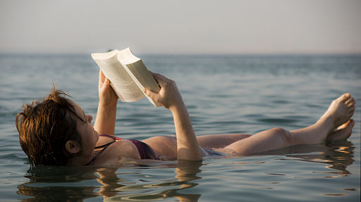 The Dead Sea - woman reading a book