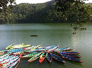 Pokhara - Phewa Lake in Pokhara. Boating at Phewa Lake is one of the popular tourist activities.