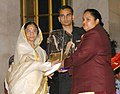 The President, Smt. Pratibha Patil presenting the Arjuna Award -2006 to Smt. Geeta Rani for Weightlifting at a glittering function, in New Delhi on August 29, 2007.jpg