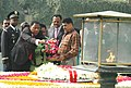 The President of Republic of Benin, Dr. Boni Yayi and his wife Mrs. Chantal de Souza-Yayi paying floral tributes at the Samadhi of Mahatma Gandhi at Rajghat, in Delhi on March 04, 2009.jpg