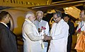 The Prime Minister, Shri Narendra Modi being received by the Governor of Karnataka, Shri Vajubhai Vala and the Chief Minister of Karnataka, Shri Siddaramaiah, on his arrival, at Misuru, Karnataka on February 18, 2018.jpg
