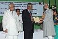 "The Vice President, Shri Mohd. Hamid Ansari presenting the ""International Gandhi Award – 2009"" to Dr. V. Pannikar, at Gandhi Memorial Leprosy Foundation, in Wardha, Maharashtra on July 01, 2010.jpg"
