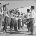 Topaz, Utah. A section of the drum and the bugle corps, a former boy scout unit, performs at the de . . . - NARA - 538723.tif
