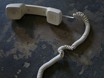 A telephone handset cord exhibiting tendril perversion