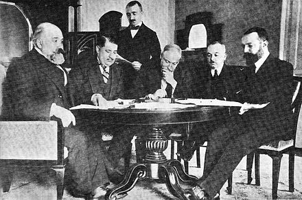 Turkish and Italian delegations at Lausanne (1912). From left to right (seating): Pietro Bertolini, Mehmet Nabi Bey, Guido Fusinato, Rumbeyoglu Fahreddin, and Giuseppe Volpi. Treaty of Lausanne 1912.jpg