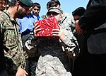 Troops Drop Off Needed School Supplies DVIDS323581.jpg