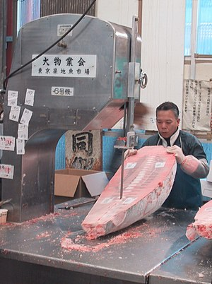 Frozen food - Cutting frozen tuna using a bandsaw in the Tsukiji fish market in Tokyo, Japan (2002)