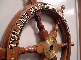 Tulane Maritime Law Journal - The Tulane Maritime Law Journal ship steering wheel adorns the entrance to the journal's student offices in Weinmann Hall.