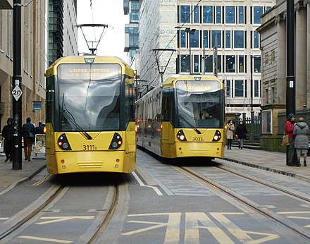 Manchester Metrolink is the largest tram system in the UK, with a total route length of 57 miles (92 km). Two M5000 trams passing.jpg