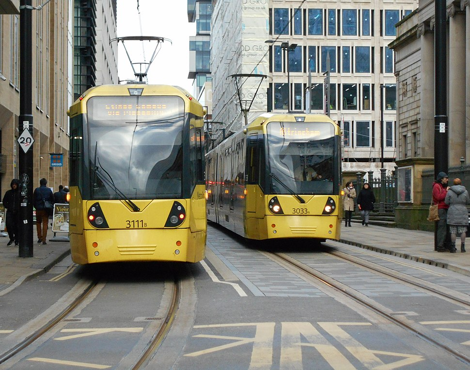 Two M5000 trams passing
