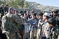U.S. Army 1st Lt. Matthew McCoy with 1st Battalion, 179th Infantry Regiment, 45th Infantry Brigade Combat Team, interacts with a local boy after a successful key leader engagement at a school in the Nurilam 120111-A-TG859-097.jpg