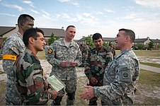 U.S. Army Lt. Col. Phillip Sounia, right, a cavalry squadron commander with the 1st Brigade Combat Team, 82nd Airborne Division, leads the final manifest call for an airborne training operation with paratroopers 130511-A-DK678-001.jpg