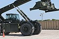 U.S. Army Sgt. Anthony Clark, a container yard noncommissioned officer in charge with the 231st Transportation Company, operates a rough terrain container handler as part of container yard operations during 120802-Z-JP950-001.jpg