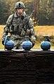 U.S. Army Sgt. Joshua Cavanaugh, with the 545th Military Police Company, walks toward a makeshift bunker where M69 fragmentation training hand grenades sit at the Kraft Range Hand Grenade Qualification Range on 120920-F-LX370-491.jpg