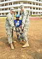 U.S. Army Staff Sgt. Tyson Pardun and Staff Sgt. Darrin Culp, with the 249th Regiment Training Institute, demonstrate an improvised litter with a role-playing Nepalese soldier during Shanti Doot 3 in Bangladesh 120310-F-KC839-119.jpg