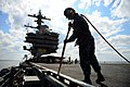 U.S. Navy Aviation Boatswain's Mate Airman Apprentice Kendrix Forbes removes foreign objects from the flight deck of the aircraft carrier USS George H.W. Bush (CVN 77) in the Atlantic Ocean May 13, 2013 130513-N-TB177-038.jpg