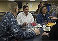 U.S. Navy Cmdr. Joel Stewart, left, the commanding officer of the amphibious transport dock ship Pre-Commissioning Unit (PCU) Anchorage (LPD 23), hosts Dan Sullivan, center, the mayor of Anchorage 130430-N-DR144-411.jpg