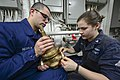 U.S. Navy Hull Maintenance Technician 3rd Class Serena Clark, right, and Hull Maintenance Technician Fireman Apprentice Shan Hedrick replace a fire main valve aboard the guided missile cruiser USS Monterey (CG 131112-N-QL471-069.jpg