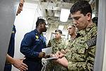 U.S. Navy Lt. Marshall Bennett, assigned to Commander Destroyer Squadron (DESRON) 50, coordinates logistics aboard the guided missile destroyer USS Hopper (DDG 70) during exercise Spartan Kopis Dec. 7, 2013 131207-N-OU681-084.jpg