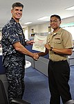 U.S. Navy Personnel Specialist 3rd Class Candelario Contreras, right, receives an award from Capt. Steve Wieman, commanding officer of Naval Air Facility Atsugi, after being named Sailor of the Week on Naval Air 120808-N-OX321-064.jpg
